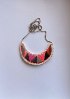 Embroidered pendant necklace crescent shaped in pinks grays and black tribal summer fashion. $30.00, via Etsy.