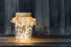 Christmas light in a glass jar against wooden boards - Buy this stock photo and explore similar images at Adobe Stock Holiday Lights, Christmas Lights, Christmas Decorations, Organic Candles, Solar Powered Lights, Indoor Air Quality, Glass Jars, Clean House, Feng Shui