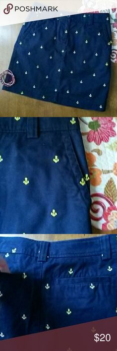 "L.L.Bean Navy Anchor Skirt! Cute, yet refined, high quality L.L.Bean nautical skirt! 100% navy colored fabric with embroidered yellow anchors. Two front pockets and two back pockets. A summer staple! Looks great with sandals, Sperrys, or even barefoot! Machine wash and dry. 17.5 inches length. Tag says petite but it is plenty long (I'm 5'6""). L.L. Bean Skirts"
