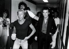 The Who's Roger Daltrey walks with Bruce Springsteen backstage at Madison Square Garden in the late 1970s.