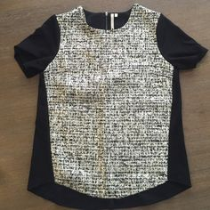 Petticoat Alley Blouse Black blouse with silver print in the front. Has a halfway zipper in the back. This top has been worn a few times but is still in good condition. Size M in women's. Tops Blouses
