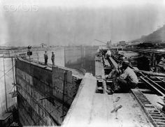 THE BIG DITCH: Construction of the Panama Canal Workers take a break at a construction site, possibly canal locks, during the construction of the Panama Canal. Panama, 1913.