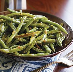 You can jazz up this basic recipe by adding Rosemary-Lemon Thyme Oil or Moroccan Spice Rub when you toss the green beans with olive oil and salt and pepper before roasting. Or toss the green beans with Sesame Sea Salt, Caramelized Shallot Butter, Ginger-Lemon Soy Splash, or Toasted Coriander & Garlic Oil after they come out of the oven.
