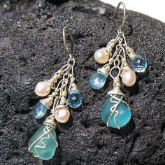 Hana Maui Online Jewelry : Kainehe Beach Glass Earrings - Kainehe means whispering sea in the Hawaiian language.    With skillfully wrapped beach glass, dainty gem stones and the timeless beauty of pearls, these earrings reflect gentle waters.    The multi faceted cut chosen for the gem stones allow light to reflect throughout. The richness of the pearls balance out the watery blues.    Wrapped in sterling silver they shimmer like the ocean.