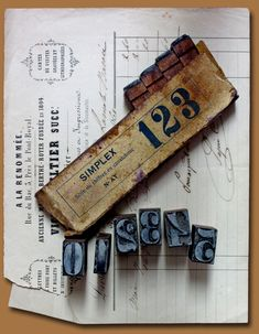 Thin rubber stamps on squared-wood bases. Old fashioned numbers. Sparkly silver.