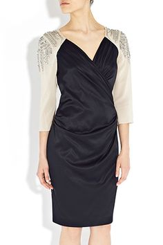 Tonias ability to design the perfect dress each and every time is further confirmed with this delightful cocktail dress. A stylish investment piece, with twisted neck detail and twisted chain embellishment at the shoulder.