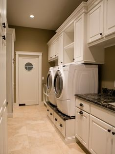 Now that's a laundry room! by geneva. I love the granite under the washer and dryer.