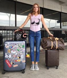 Not packing light: Chiara, 28, is seen standing next to her bags as she jets from Los Ange...