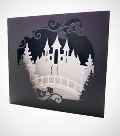 Castle Bridge Shadow box card  This card measures approx 5 x 5 x 2 The whole card was cut from heavy cardstock   The instant download formats available for this design are SVG for a variety of electronic cutting machines DS.svg for Cricut Design Space  theres a Scan and Cut zip folder and a Studio compatible zipped folder for Silhouette  Heres a link to some step by step instructions to making these Shadow Box cards Please note that the instructions may show a different card being assembled…