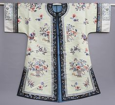 "Antique Chinese Embroidered Silk Robe    Chinese, late 19th or early 20th century, the pale green robe embroidered with scattered vases and flowers, linked in blue silk. 40 1/2""L. 441/2""W."