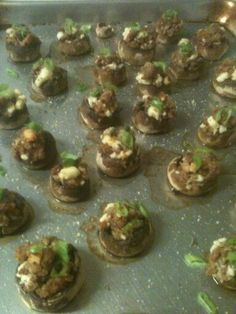 Stuffed mushrooms with spicy sausage, feta cheese and scallions.