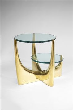 Philippe Hiquily (French, 1925–2013) Low table with two tops / pedestal table with two plates ca. 1970 Beaten brass with blue crystal top / Brass hammered with two asymmetrical crystal plates cast 60 x 73 x 54 cm. (23.6 x 28.7 x 21.3 in.)