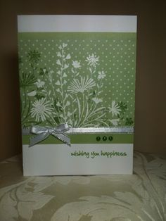 Flower silhouettes stamped twice on printed paper, first in monochromatic green over polka dots, second with VersaMark & embossed with glittery white or else dusted with Perfect Pearls.