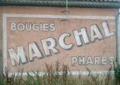 Marchal bougies, phares,belle publicité située dans un hameau sur un tronçon abandonné. Commune de Gauriaget (Gironde, km 526) France