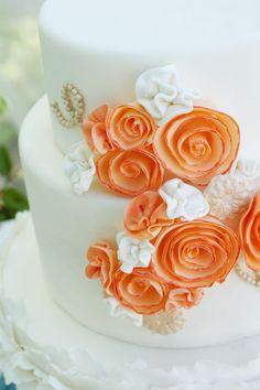 Orange & White Wedding Cake... will change those flowers to blue and yellow!!! THANKS