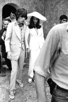 Against a shabbily chic European backdrop, clad in a cream trouser suit and matching, floppy-brimmed hat by Stella McCartney, the bride evoked more than a striking resemblance to Bianca Jagger at her San Tropez wedding to Mick Jagger