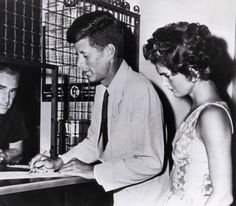 John F. Kennedy and Jackie signing their marriage license in 1953.