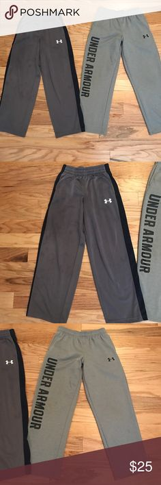 Under Armour boys pants - 2 pair both size Medium Under Armour boys pants - 2 pair both size Medium. Grey pair with pockets, navy stripe and Under Armour written in white in better condition than what photo shows - looks like with flash that there are spots all over them and while there are a couple (that I actually think are from fabric softener) they look better than that in person!! The second pair are also grey with pockets and have UA written in black. Great condition! Perfect for…