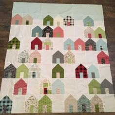 I'm loving how my #suburbsquilt turned out! This pattern is so quick and fun. I can quilt it before Christmas! #cluckclucksew #sweetwaterfabric #hometownchristmasfabric #camiesquiltsof2017