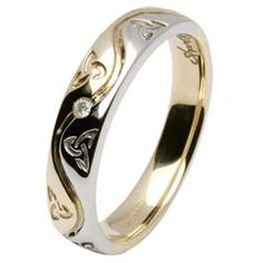 Celtic wedding band- I'd rather have it be all silver but I do really like this. Not sure if it would work with my engagement ring though.