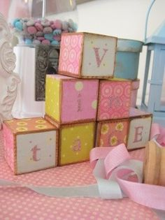 Vintage pastel baby blocks, $22 from Etsy or if she's sold out, make you own with Washi tape and sandpaper (to make old looking).