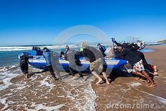 Scuba diving boat with skipper and divers launching boat off the beach into ocean surf destination aliwal shoal marine sanctuary off Umkomass south coast from Durban South-Africa. Image Photography, Editorial Photography, Durban South Africa, Wide Angle, Scuba Diving, Underwater, Surfing, Places To Visit, Coast