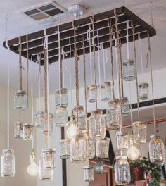 mason jar chandelier — the painted arrow  Lighting  I don't like this one as much as mom's...  But in a pinch...