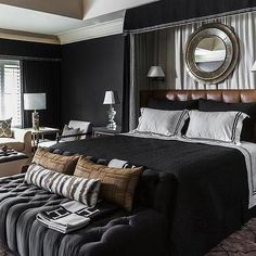 Black Bedroom with Curtains Behind Headboard