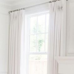 Stunning two-fold pinch pleat panels in our House Linen Winter with silver hardware.  Buy these today online!  http://www.qdesigncentre.com/store/category/perfect-hardware