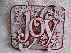 Joy christmas card...clever ideas for things to do with my silhouette, not necessarily for Christmas, but any card. :)  Cricut Cartridges- Winter Woodland (Joy), winter Lace (Snowflakes), Ashlyn's Alphabet (Swirl), George (Rounded rectangle).