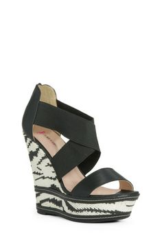 KARI Take a walk on the wild side in this printed wedge. Faux leather and an open toe will bring your look from totally tame to fabulously fierce.