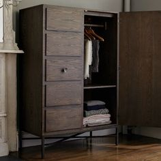 west elm wardrobe...diy, we could repurpose our hideous entertainment center into something similar.