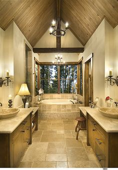 Lodge style bathroom. Love the vanity and symmetry.