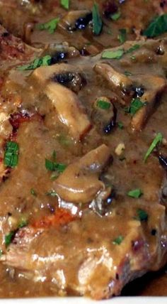 Smothered Pork Chops with Mushroom Gravy ~ pork chops smothered in an amazingly rich and savory mushroom gravy while using simple, good-for-you ingredients with no butter and NO CANNED SOUP!