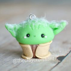 Yoda Cupcake! Remember the Ewok Cupcake? He and his buddies finally made it to their new home so I can finally now show y'all the rest of them. :) I used cut up pieces of feather to make his head all fuzzy. ------------------------------------------------------------------ #polymerclay #claycharms #clay #charms #jewelry #food #foodie #art #artwork #artist #foodpics #kawaiifood #cutefood #nerdy #nerd #handmade #diy #etsy #crafts #new #love #cupcakes #starwarscupcakes #starwars #yoda #jedi…