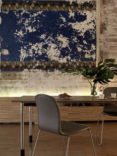 A worn mural left in place benefits this room, as does the concealed uplighting that highlights it. Barcelona.