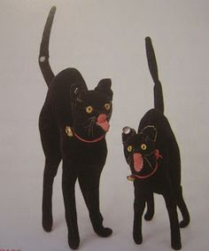 """Two size variations of Tom Cat by Steiff, 1904, Germany.  The larger of the two has a """"muster"""" button in his tail, denoting that his is a sample or prototype from Steiff's workshops."""