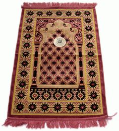 """A prayer mat rolled in the corner of the room"""