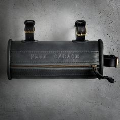 A compact and cleverly designed accessory for cyclists. This is a slim, discreet bicycle bag that can be easily attached to the frame or bars. Offering convenient carrying of tools, this genuine leather bag is both flexible and durable. Leather Bicycle, Saddle Leather, Leather Bag, Bicycle Tools, Bicycle Bag, Hand Wax, Frame Bag, Dopp Kit, Work Fashion