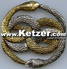 """A replica of the Auryn medallion from """"The Neverending Story"""", made from metal. This Auryn was molded off of the original Auryn used in the film."""