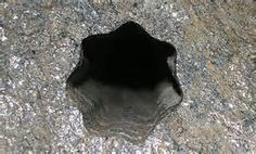 The 7 edged star mystery in Volda, Western Norway    On Friday the 30th of november 2007, a concstruction worker discovered a 7 edged drilling hole on the base of a mountain during construction work on a new parking lot. So far, it appears that no one has seen a hole similar to the 7 edged star, or have been able to explain how it was made.