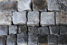 "Reclaimed ""blue-black"" cobblestones in basalt. Cobbles in dark grey. Antique reclaimed pavers"