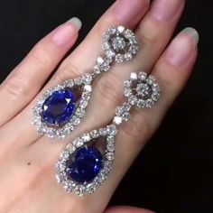 @dehres A dazzling masterpiece! A pair of 13 carats each Oval Shape unheated Burmese Sapphire dangling earrings, surrounded by 10 carats