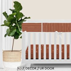 For our modern + minimal momma's out there. This Rust Red modern bumperless nursery look is complete with hand drawn stripes + coordinating Swiss cross pattern. We love how this look is modern and simple - leaving all the room for the baby to shine. Available in (9) color ways.