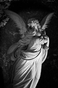 angel statue at Tomba Bruzzone by Giacomo Moreno, 1896, Monumental Cemetery of Staglieno, Genova, Italy
