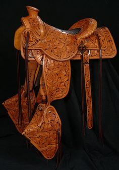 "Frecker's Western Saddles-Full Tooled Selway Packer. 3 ½"" cantle. Rope roll front and cantle. Elephant skin padded seat. 21"" drop tapaderos. Matching saddle bags. Made by David Rigby  WHAAAT"