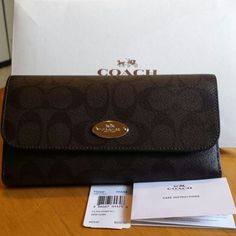 Authentic Coach checkbook wallet Brandnew with tags coach checkbook Comes with gift box and coach paper bag Includes checkbook with pen loop Excellent condition never used Price firm Coach Bags Wallets