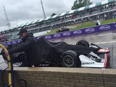One of the @Team_Penske cars on pit lane. Still covered, but rain is lightening. #DetroitGP