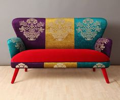 Handmade two seater sofa upholstered with colourful Gobelin and red velvet fabrics mix.
