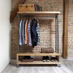Industrial Style Clothing Storage Unit This clothing unit has a great industrial look and simple stylish storage solution for hanging clothes and hats; displaying shoes and accessories. It's made of reclaimed pinewood and 1' inch steel pipes. The rail is sturdy and can hold a good amount of weight freestanding. Unit has one top shelf and bottom shoe rack, which should provide you with good amount of storage space. This item can be custom-made to your own size and specification.  Product…